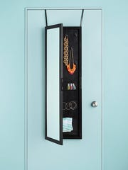 This over-the-door full-length mirror also provides storage space.