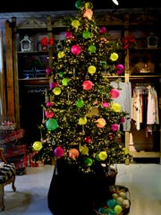 In addition to all manner of gifts for sale, Mik's also sells Christmas trees and hand-blown glass bulbs.