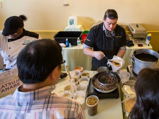 Celebrity chef Katsuji Tanabe serves guests his dish, which featured Kobe beef tongue tacos layered with a deeply flavored almond mole sauce, at the 20th Annual Celebrity Chefs Brunch held at the DuPont Country Club in Wilmington on Sunday afternoon.