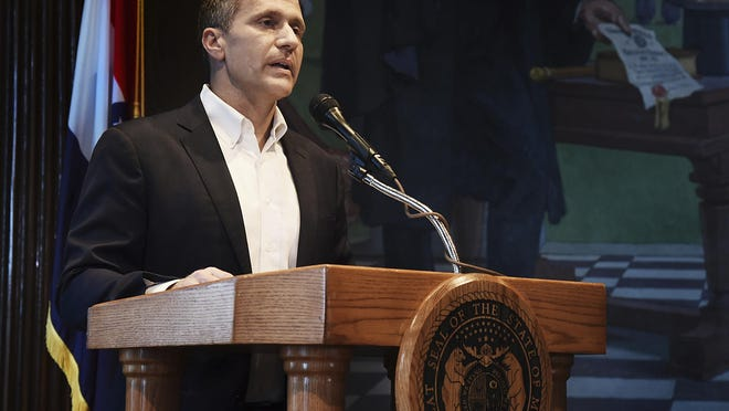 Missouri Gov. Eric Greitens reads from a prepared statement as he announces his resignation during a May 2018 news conference at the state Capitol. Greitens resigned amid a widening investigation that arose from an affair with his former hairdresser. He filed paperwork this week indicating he may return to politics in 2024.