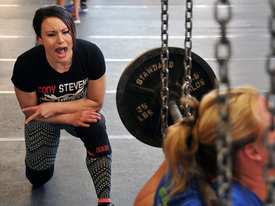 Melissa Stevens encourages fellow powerlifter Holly