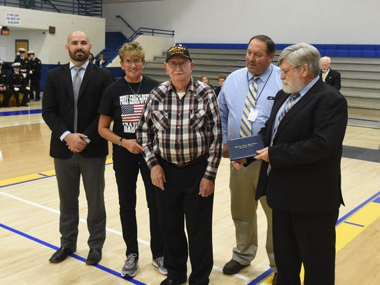 Louis Carrillo Jr. (center) is presented with an honorary