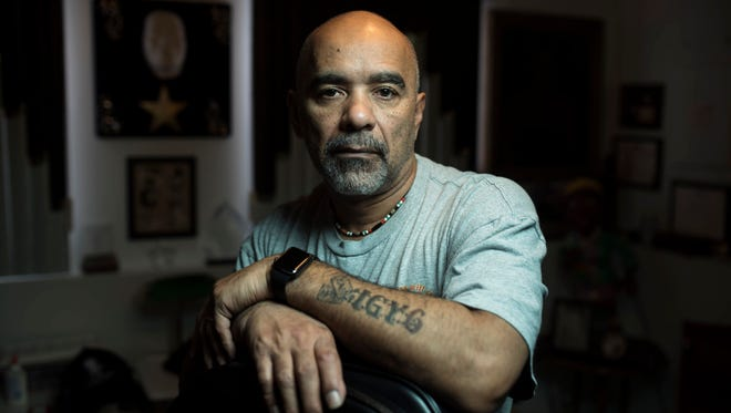 William Thomas, a retired police sergeant and Air Force veteran acquired PTSD in Iraq. On his forearm is a tattoo of USAF dog tags; I.G.Y. 6 -- which stands for I Got Your 6; and a semicolon for suicide awareness.