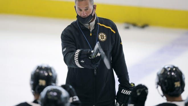 Bruins coach Bruce Cassidy instructs his players Tuesda during the team's practice.