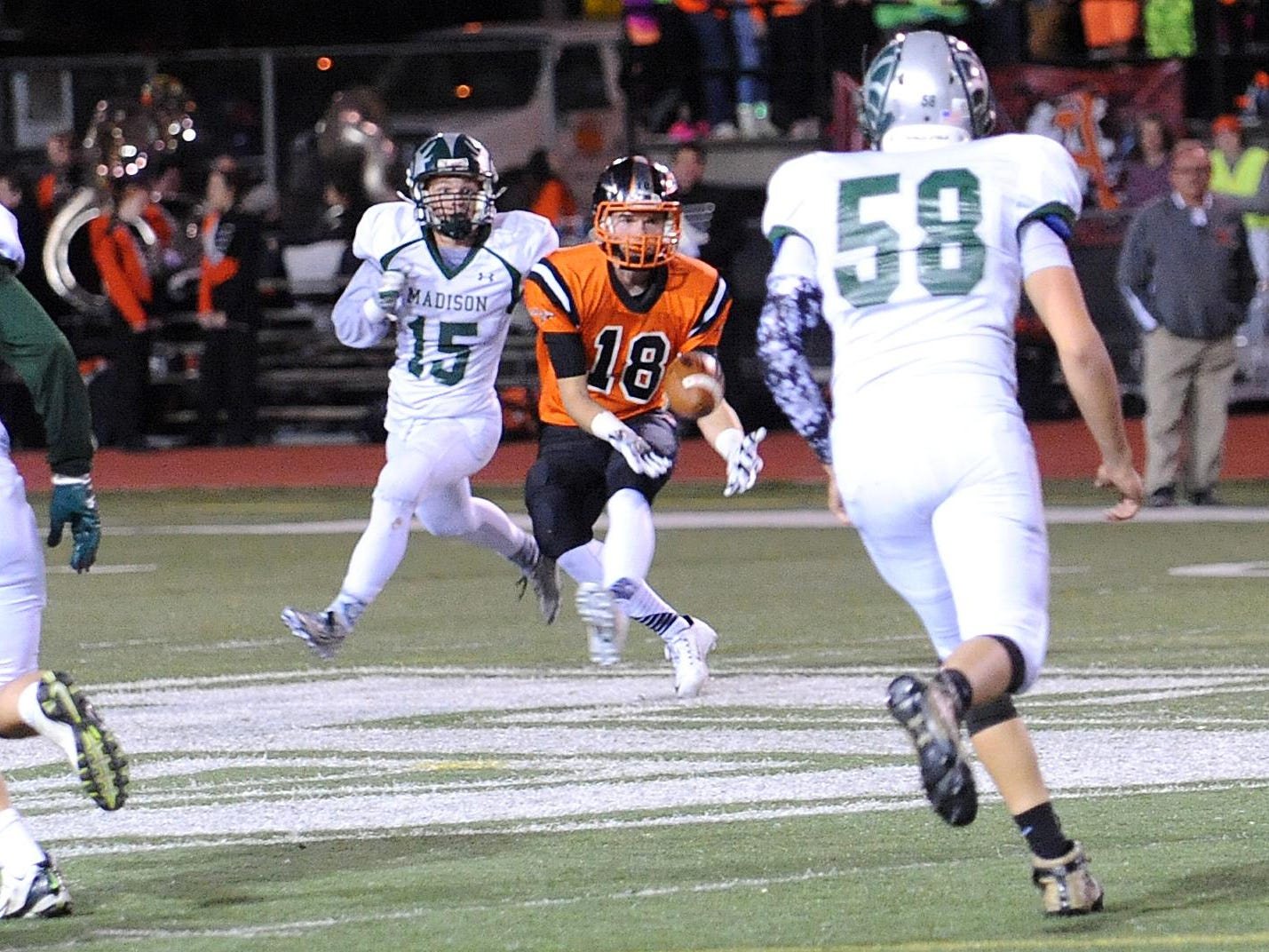 Ashland's Nick Bernhard receives a pass Friday night during their game against Madison.