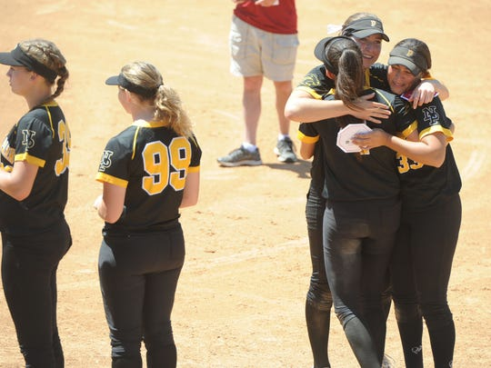 Newbury Park High softball players celebrate after their 3-1 win over Riverside-ML King in the CIF-SS Division 2 championship game Saturday in Irvine.