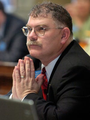 In this file photo, Michael Lange sits in the House chambers in Helena on April 25, 2007.