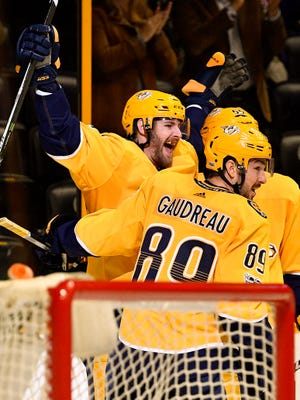 The Predators' Austin Watson (51) celebrates with teammates Cody McLeod (55) and Frederick Gaudreau (89) after scoring against the Avalanche on Tuesday.
