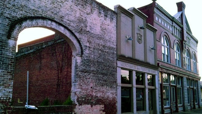 "This Oct. 1, 2013 photo shows the archways and brick wall of an old building in Grantville, Georgia, that was used to film a scene in the AMC TV drama ""The Walking Dead."" Tourists come to the west Georgia town to see the wall and other nearby buildings where scenes from the show were filmed."