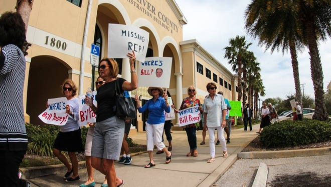 Protesters rally outside U.S. Rep. Bill Posey's office in Indian River County on Feb. 21, 2017 to ask him to stand up against President Donald Trump's agenda.
