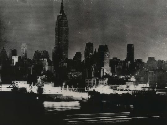Manhattan skyscrapers and apartment buildings are dark shortly after 6 p.m. on Nov. 9, 1964, during New York's massive blackout.