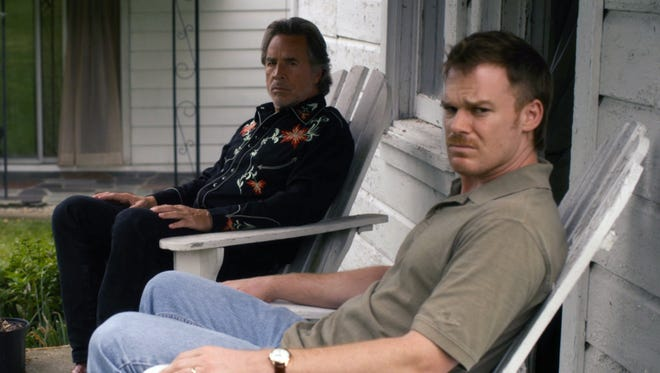 Don Johnson (left) and Michael C. Hall in a scene from the film 'Cold in July.'