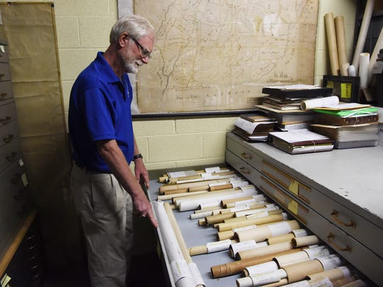 Michael Frazier, archivist for the Rhinebeck Historical Society, opens up a drawer full of  the Teal maps in the basement of the Starr Library, where the Rhinebeck Historical Society is headquartered.