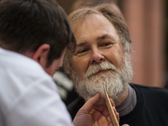 Kenneth Griffith has his beard measured during the