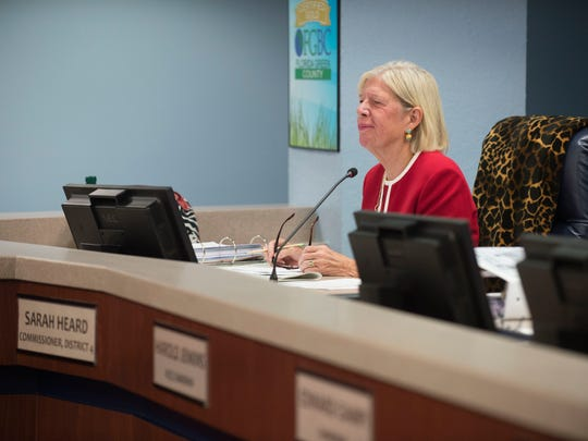 Commissioner Sarah Heard listens to public comment during the Martin County Commission meeting Dec. 12, 2017 at the Martin County Administration building in Stuart. Commissioner Ed Fielding and former commissioner Anne Scott were recently charged with violating public records law relating to a civil lawsuit with Lake Point Restoration, a rock quarry in western Martin County. Commissioner Heard pleaded not guilty to a noncriminal infraction related to violating state public records law.