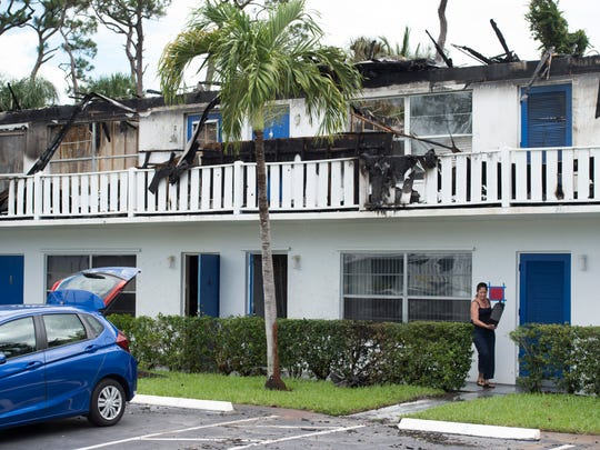 """It's brutal,"" said Cedar Pointe Villages resident Linda Vincelli, of Stuart, on Tuesday, May 29, 2018, as she moved out belongings from her condo unit following Monday night's fire that destroyed the building. ""I'm just so upset. My place was so cute. I have a mortgage. What will I do now?"" The fire was contained to the top floor, but Vincelli and others' bottom floor units were damaged by flooding."
