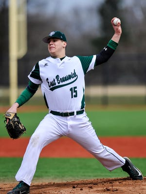 East Brunswick's Tyler Burnham delivers a pitch against St. Joe's in a game on Apr.1, 2017.