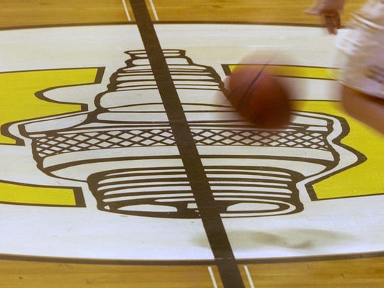 """A Sparkplug is painted atop a large """"S' at center court in the Speedway Junior High School gymnasium originally the high school gym built in 1937."""