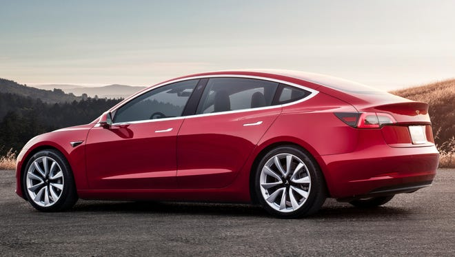 This undated photo provided by Tesla shows the Tesla Model 3, which delivers a sporty ride with a premium feel. The Model 3 is dramatically quicker and more engaging to drive than other popular EVs such as the BMW i3 and the Chevrolet Bolt.