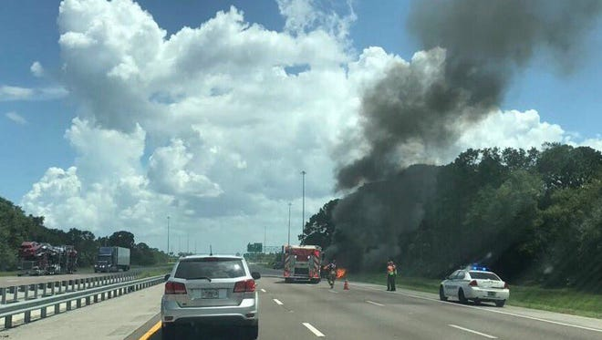 A passenger vehicle drove into the woods and burst into flames Tuesday afternoon on Interstate 95 near Canaveral Groves.