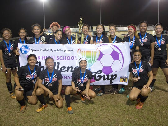 The Simon Sanchez High School Sharks pose with their champions medals and trophy following the 2018 Challenge Cup Girls High School Preseason Soccer Tournament title match at the Guam Football Association National Training Center. The Sharks defeated the Southern High School Dolphins 1-0 in a penalty kick shootout.