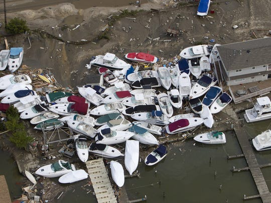 Boats were tossed on top of each other in a marina