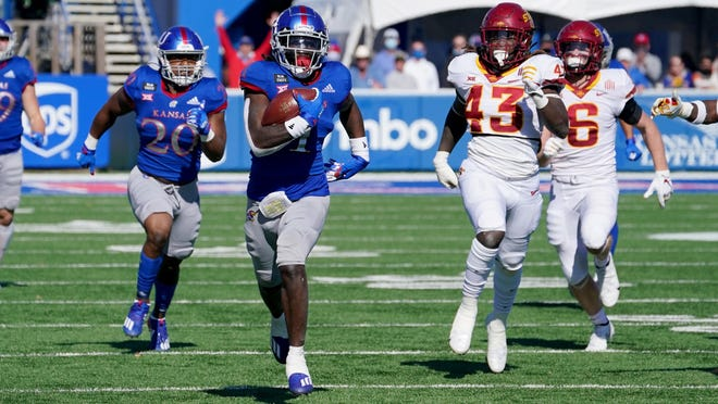 Kansas safety Kenny Logan puts the finishing touches on a 100-yard kickoff return touchdown during Saturday's game against then-No. 23 Iowa State at David Booth Kansas Memorial Stadium in Lawrence. Logan, a sophomore, also had an interception in the contest, but the Jayhawks lost 52-22.
