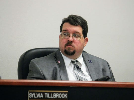 County Attorney Michael Eshleman listens to an agenda