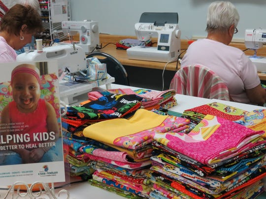 A one-day stack of pillowcases are ready to go for Ryan's Case for Smiles. More than 150 pillowcases have been made for the Christmas season, as part of the giving effort by the all-volunteer group at Quilters Choice in Jupiter.