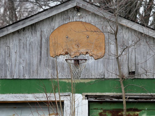 When they were boys, Brad Tucker and his late brother, Chad Tucker, used to play basketball using a hoop mounted to the barn on their parent's property near the intersection of Ind. 42 and Ind. 231 in Cloverdale, shown on Monday, Dec. 22, 2014. Chad, Butler University's all-time leading scorer, killed himself by carbon monoxide poisoning at age 31 in 1996, and Brad recently spoke with The Indianapolis Star about it.