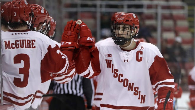 Wisconsin forward Luke Kunin is congratulated by teammates after scoring during the first period.