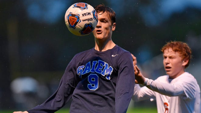 Salem's Christian Freitag (No. 9) watches the ball Thursday while Canton's Aidan Hurley intervenes. Freitag was the hero for the Rocks with all three goals.