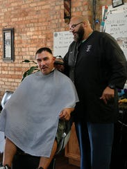 Paul Trowbridge, owner of Cuttin Up Barber Shop in