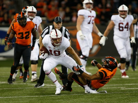 Stanford wide receiver JJ Arcega-Whitesside sheds an Oregon State defender during the first half of an NCAA college football game, in Corvallis, Ore., Thursday, Oct. 26, 2017. (AP Photo/Timothy J. Gonzalez)
