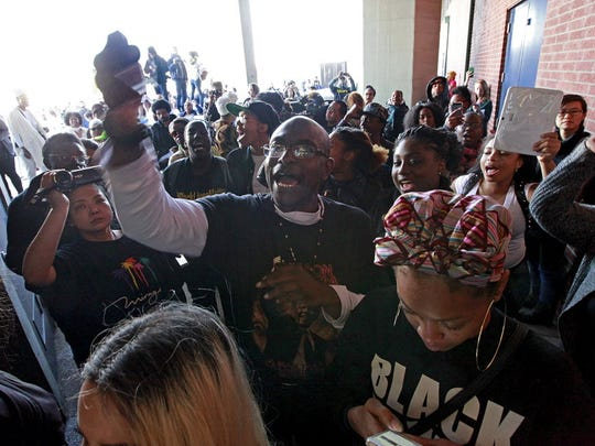 """A group of protesters chant """"Black lives matter"""" outside"""