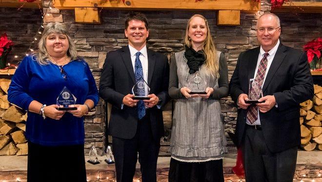 Shari Lewis, Joel Moenkhoff and Elizabeth Behan accepts awards from Fairview Area Chamber president Jon Cherry.
