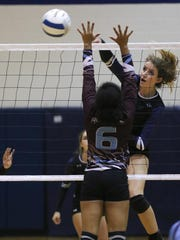 Piedra Vista's Courtney Moore gets a kill against Ganado, Ariz., on Sept. 9 at the Jerry A. Conner Fieldhouse in Farmington.