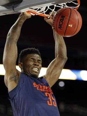 Syracuse's Chinonso Obokoh, who attended Bishop Kearney, dunks during practice at the 2016 NCAA Final Four.in Houston.