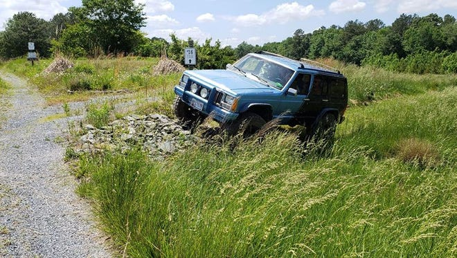 A jeep goes through the course at the Deer Run Jeep Golf course, opening June 2.