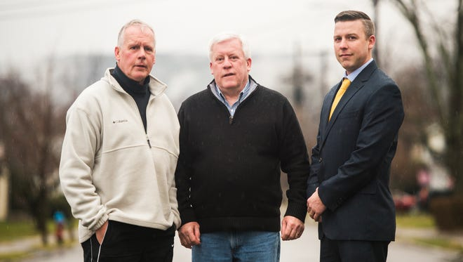 From left, brothers Kevin and Terrence Helsin, and Terrence's son Conor, who have all served as Binghamton police officers.