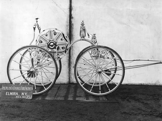 This photo shows an early piece of hand-pulled fire fighting equipment manufactured by American LaFrance in Elmira. The company also produced horse drawn equipment, and delivered its first motorized fire engine in 1907.