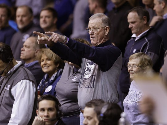 Butler superfan Wally Cox, who played as freshmen with Bobby Plump in 1954-55 and now sits in the first row behind the scorer's table and cheers on his Butler Bulldogs.