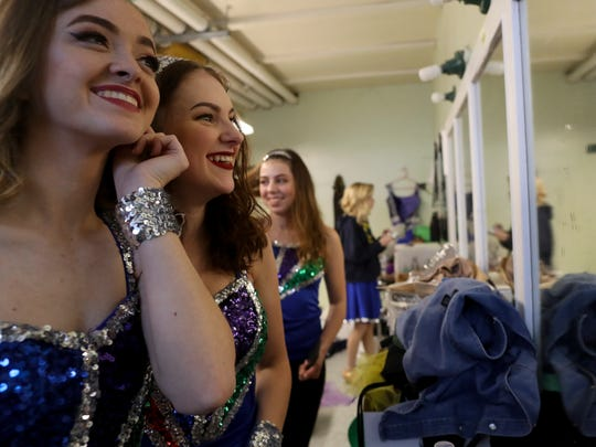 Enterprise High School seniors Christina Balding, from left, Cheyenne Harrah, and Hailey May get ready to take the stage Tuesday at the David Marr Theatre in Redding.