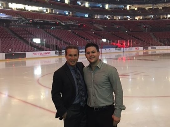 Red Wings play-by-play broadcaster Ken Daniels, left,