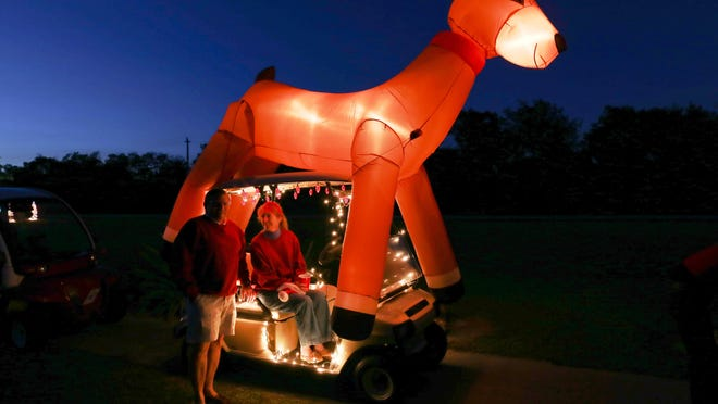 One of the animated golf carts that joined the Annual Christmas Golf Cart Parade in 2014.