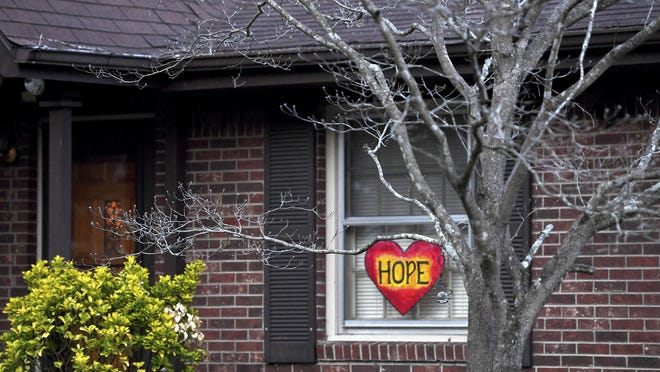 "A home is East Asheville displays a heart with the word ""hope"" in the window as the nation copes with the spread of novel coronavirus on March 27 in Asheville."