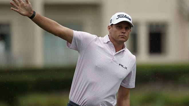 In this photo taken Thursday, June 18, 2020 Nick Watney signals after a tee shot during the first round of the RBC Heritage at Harbour Town Golf Links on Hilton Head Island, S.C. Watney has tested positive for coronavirus and did not play in Friday's round.