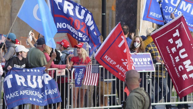 Supporters of President Donald Trump gather outside Walter Reed National Military Medical Center on Sunday.