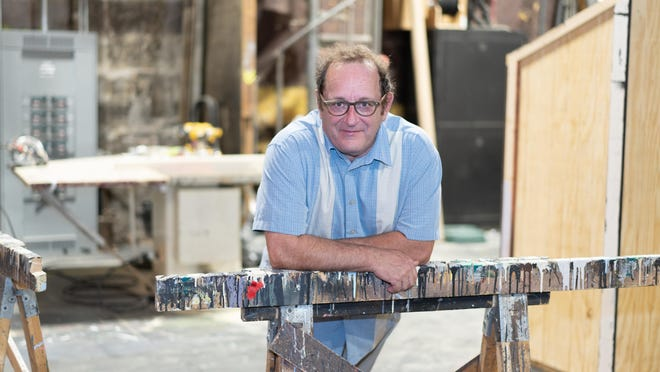 John MacNaughton is pictured July 29 backstage at the Croswell Opera House. MacNaughton has retired as the Croswell's artistic director