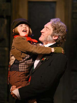 Tiny Tim Cratchit and Ebenezer Scrooge appear in 'A Christmas Carol' at Geva Theatre Center, which will continue through Dec. 24, 2016.